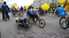 Disabled men participate in bicycle parade around the city centre. Moscow, Russia - May 28, 2017: Disabled men participate in bicycle parade around the city stock footage