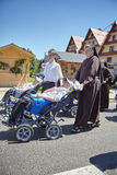 Disabled men on wheelchairs during Corpus Christi procession through a main street of Bialka Tatrzanska. Bialka Tatrzanska, Poland - June 15, 2017: Disabled men Stock Images