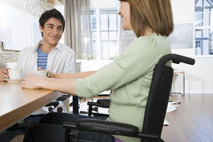 Disabled mother with son Royalty Free Stock Photography