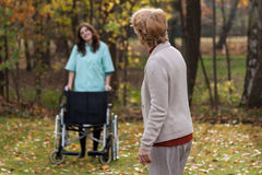 Disabled with nurse on a fresh air Royalty Free Stock Images