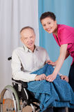 Disabled and a nurse smiling Royalty Free Stock Photos