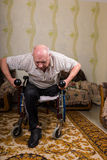 Disabled old man leaned and doing exercises Stock Photography