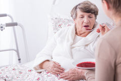 Disabled old woman having care. Picture of disabled old women having care Royalty Free Stock Photo