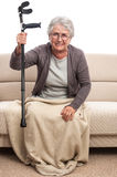 Disabled old woman in pain Royalty Free Stock Image