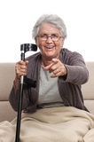 Disabled old woman pointing Stock Images