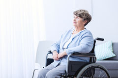 Disabled old woman on wheelchair. Image of disabled positive old woman on wheelchair Royalty Free Stock Photography