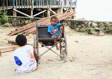 Disabled papuan child Stock Photos