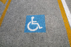 Disabled parking permit sign painted on the street Royalty Free Stock Photography