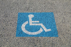 Disabled parking permit sign painted on the street Royalty Free Stock Photo