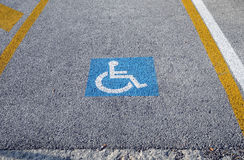 Disabled parking permit sign painted on the street Royalty Free Stock Images