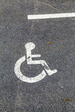 Disabled parking permit sign on the street Royalty Free Stock Image