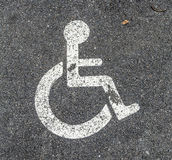 Disabled parking permit sign on the street Royalty Free Stock Photo