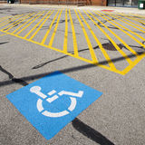 Disabled parking sign. Painted on the road royalty free stock images