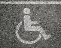 Disabled parking sign on asphalt Royalty Free Stock Photography