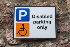 Disabled Parking Only Sign. A Disabled Parking only sign attached to a wall stock image