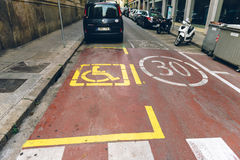 Disabled parking sign in Barcelona Spain. BARCELONA SPAIN, JUN 29, 2016: Disabled parking sign next to 30 km zone in urban enviroment, Barcelona, Spain street Royalty Free Stock Photography