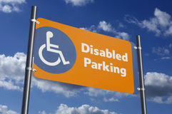 Disabled parking sign with blue sky Royalty Free Stock Images