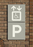 Disabled parking sign on brick wall Stock Photos