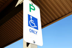 "Disabled Parking Sign. A disabled parking sign : green letter P, blue wheelchair and blue text ""ONLY Royalty Free Stock Photos"
