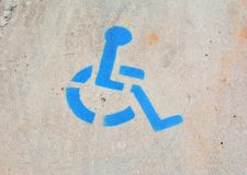 Disabled parking sign painted on asphalt. Royalty Free Stock Image