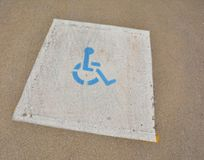 Disabled parking sign painted on asphalt. Royalty Free Stock Photo
