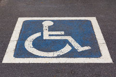 Disabled Parking sign at parking lot. Royalty Free Stock Photo