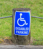 A disabled parking only sign on the street side, for providing c Royalty Free Stock Photos