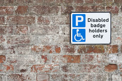 Disabled parking space plate on brick wall. Disabled parking space sign on brick wall in  Suffolk, UK Royalty Free Stock Photography