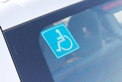 Disabled parking sticker tag on car Stock Photography
