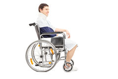 Disabled patient with broken arm in a wheelchair Stock Photography