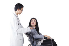 Disabled patient talking with her doctor Stock Photos