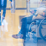 Disabled people active for life. Handicapped male businessman on a wheelchair using smartphone. Disabled people active for life Royalty Free Stock Photos