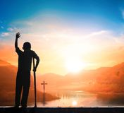 Disabled people victory concept: a disabled person in front of the cross stock images