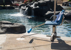 Disabled person chair swimming pool Stock Photos
