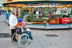 Disabled person in Christmas market Royalty Free Stock Photography