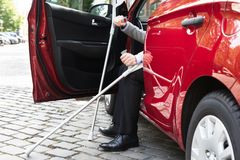 Disabled Person Getting In A Car Stock Photo - Image of opening
