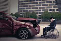 Disabled person and damaged car Stock Photography