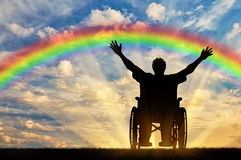 Disabled person with a nurse, happy rainbow. Disabled concept. A disabled person with a nurse, happy rainbow and sea sunset Royalty Free Stock Images