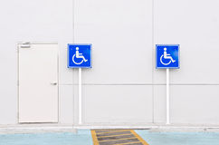 Disabled person parking sign Stock Photos
