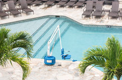 Disabled person pool lift by swimming Royalty Free Stock Image