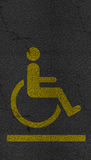 Disabled person sign asphalt highway road texture Stock Photography