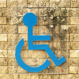Disabled person sign. On brick wall Royalty Free Stock Image