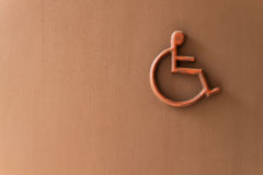 Disabled person sign on  wall Stock Photo