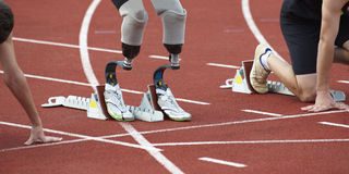 Disabled person in sport. Disabled person legs on track in sport Stock Photography