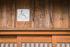 Disabled person toilet sign on old wood wall. Stock Image