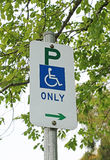 Disabled persons parking sign with a background blur Royalty Free Stock Photos