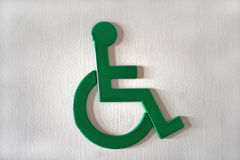 Disabled persons sign. Disbled persons sign on restroom door Stock Images