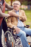 Disabled positive elderly man in wheelchair. Support disabled positive elderly men in wheelchair Royalty Free Stock Photography