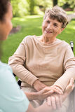 Disabled positive elderly woman. Image of disabled positive elderly women on wheelchair Stock Photo
