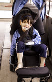 Disabled preschool boy in wheelchair on bus Royalty Free Stock Image